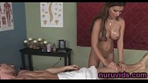 Busty brunette masseuse plays with a cok